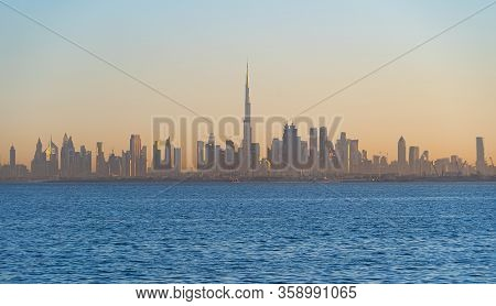 Dubai Downtown Skyline With Waves On Sea Beach, United Arab Emirates Or Uae. Financial District In T