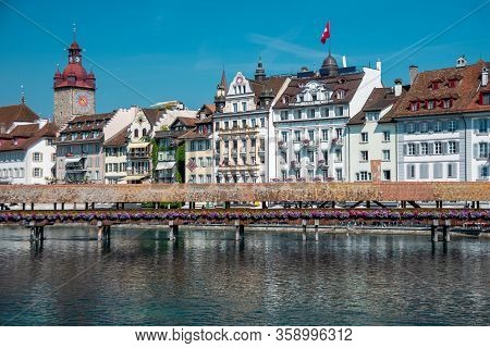 Famous Chapel Bridge, The Citys Symbol And One Of The Switzerlands Main Tourist Attractions On Sunny