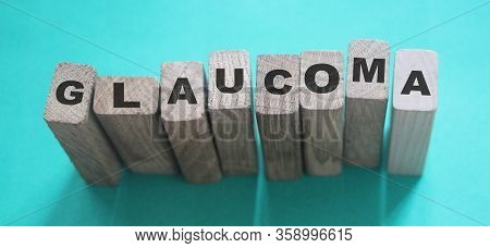 Glaucoma Word Made With Wooden Blocks, Eye Healthcare Medical Concept