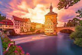 Bamberg City In Germany. Town Hall Building In Background With Blue Cloudy Sky.  Architecture And Tr