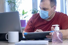 Quarantine Due Coronavirus Pandemic. Stay At Home. Business Man Working From Home, Wear A Protective