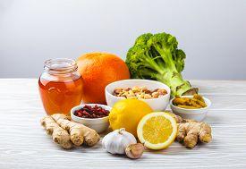 Food For Immunity Stimulation And Viruses Protection. Broccoli, Citrus Fruits, Honey, Ginger, Lemon,