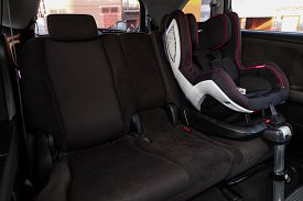 Novosibirsk, Russia - March 30, 2020  Honda Stream, Close-up Of The Black  Rear Seats With Baby Car
