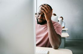 Upset, Sad Man Is Sitting At Computer. Job Search, Crisis, Unstable Situation.unemployed Jobless Peo