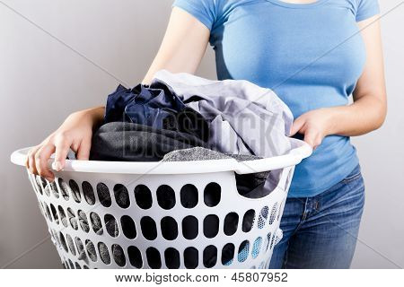 Woman Holding Dirty Laundry