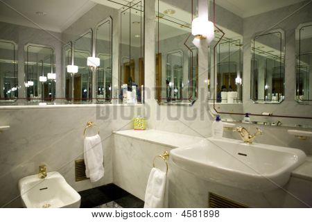 Restroom With Mirrored Walls