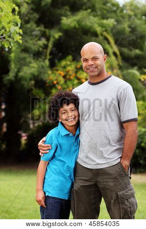 Happy and relaxed mixed race father and son