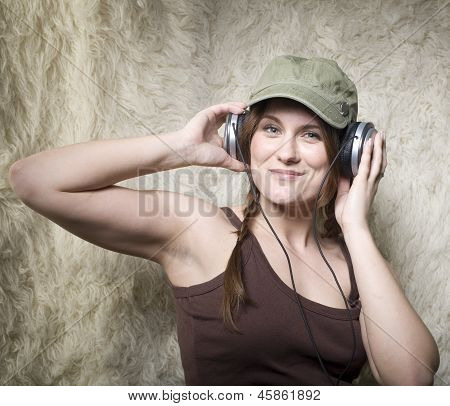stock photo closeup portrait of a beautiful young lady smiling listening music