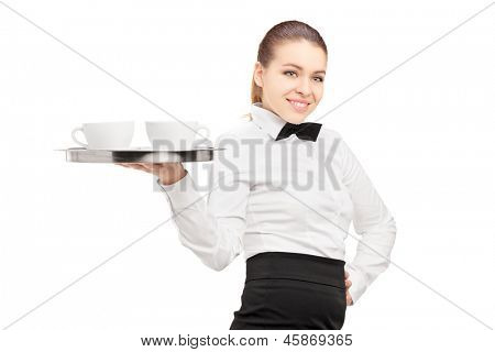 A waitress with bow tie holding a tray with coffee cups on it isolated on white background