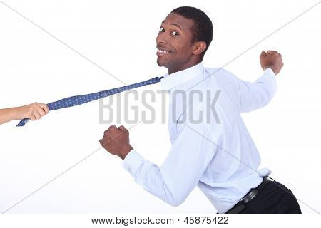 Woman yanking a man across shot by his tie
