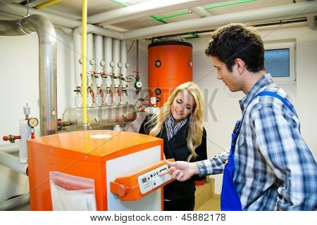 young heating engineer in boiler room for heating system