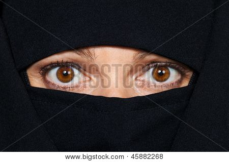 symbolfoto islam. muslim burqa is with obscured.