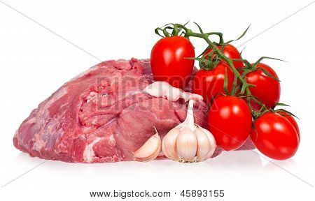 Raw pork with ripe tomatoes and garlic cloves isolated on a white background poster