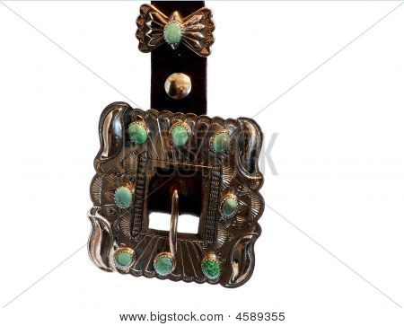 Beautifully handcrafted Native American silver and turquoise belt buckle isolated on white. poster