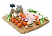 fresh vegetables spices quail eggs and raw chicken wings on chopping board isolated on white background poster
