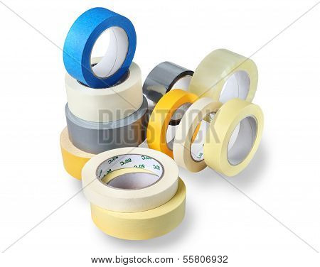 Several Rolls Of Adhesive Tapes Of Different Colors, Sizes, Purposes.