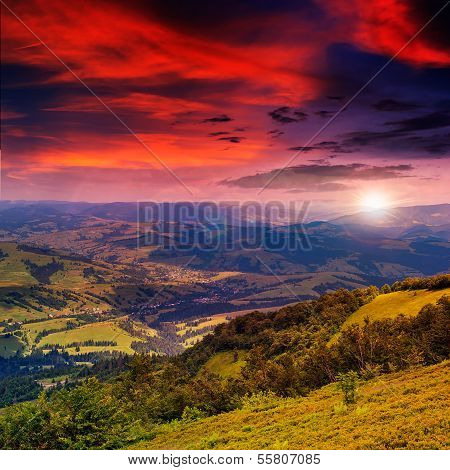 Light  Beam Falls On Hillside With Autumn Forest In Mountain On Sunset