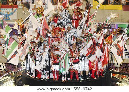 RIO DE JANEIRO - FEBRUARY 04:The group Samba the dancer dressed up on footballers for Rio de Janeiro Carnival in Sambadome February 04 2008 in Rio de Janeiro de Janeiro Brazil. Rio is the largest carnival in the world de Janeiro Carnival. poster
