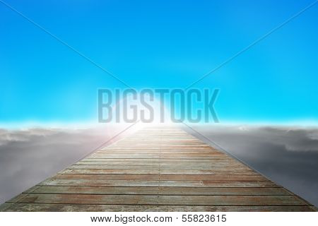 Wooden Way Direct To Sun With Cloudy Below And Blue Sky