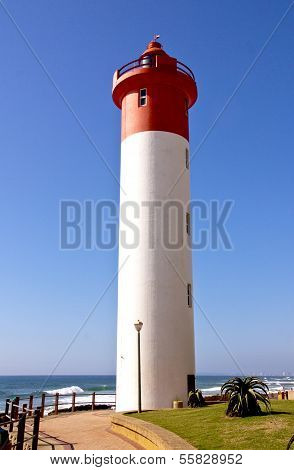 Upward Looking View Of Red And White Lighthouse