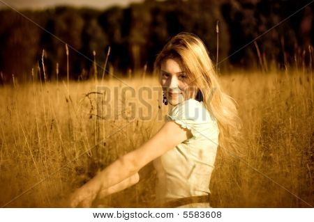 Young Woman In High Grass