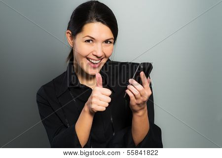 Woman Cheering At Good News On Her Mobile