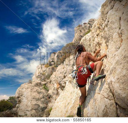 Young man climbing