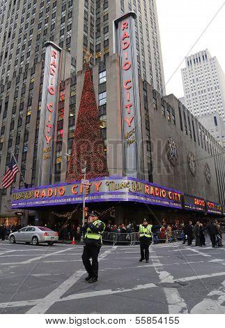 NYPD officers regulate traffic during gridlock near New York City landmark Radio City Music Hall