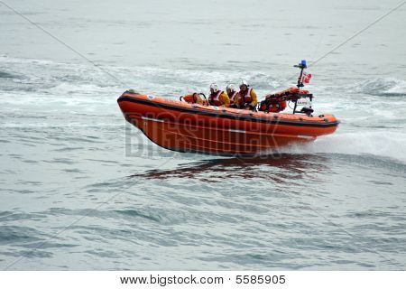 Lifeboat / life boat of the R.N.L.I. coastguard near Worthing, UK