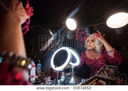 Man Fixing Hair In Mirror
