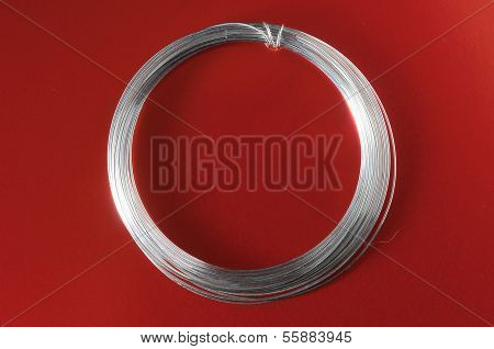 Jewelry Silver Wire on a Colored Background poster