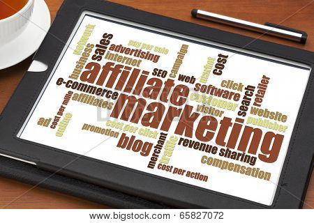 affiliate marketing word cloud on a digital tablet with a cup of tea