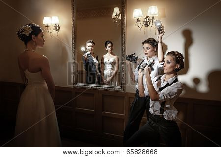 Female  photographers are taking a picture  poster