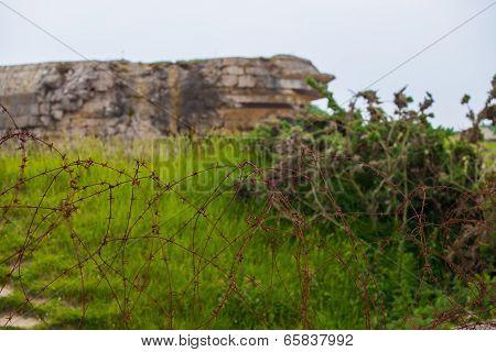 Old Broken German Bunkers Of Atlantic Wall On Pointe-du-hoc. Western End Of The Omaha Beach Sector,