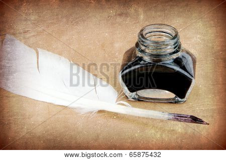 Quill pen and ink bottle,