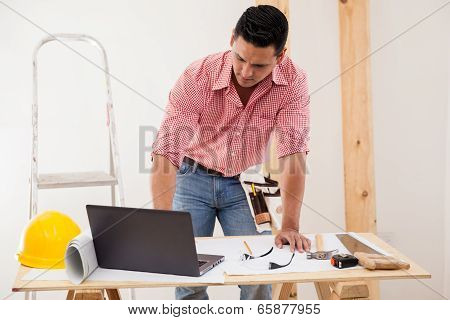 Contractor Using A Laptop At Work