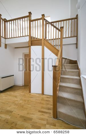 Split Level Living Room With Staircase And Study Room