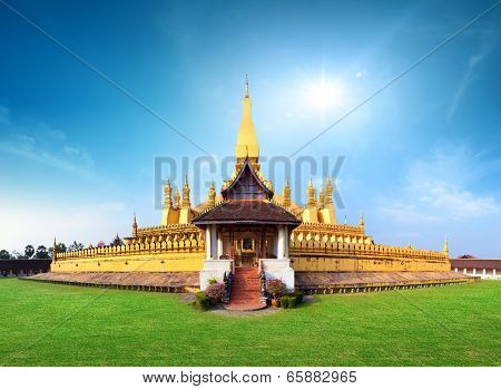 Laos travel landmark, golden pagoda wat Phra That Luang in Vientiane. Buddhist temple. Famous tourist destination in Asia