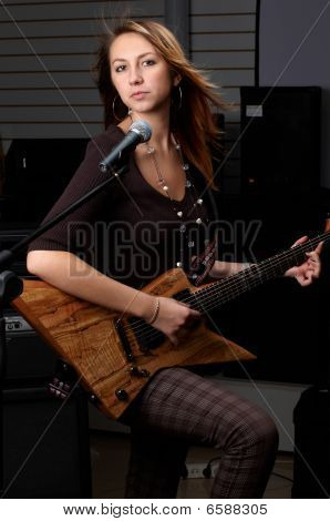 Young Female With Rock Guitar