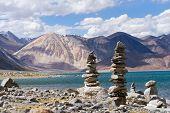 Pangong Tso mountain lake panorama with Buddhist stupas in forefront (Ladakh India) poster
