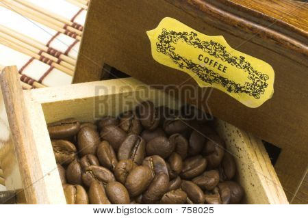 Coffee grinder drawer filled with coffee beans