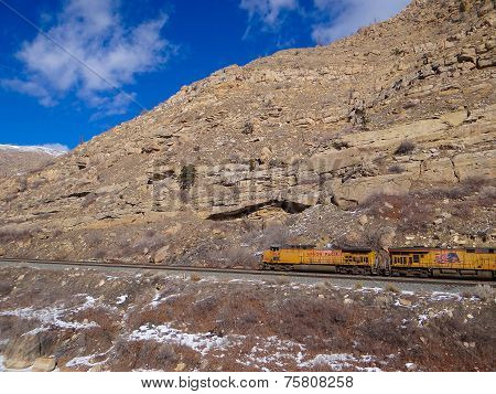 Freight Train In Narrow Canyon
