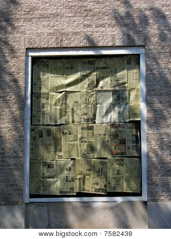 Old newspapers in the window