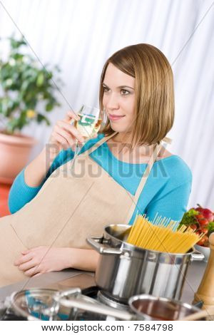 Cooking - Young woman with spaghetti and wine