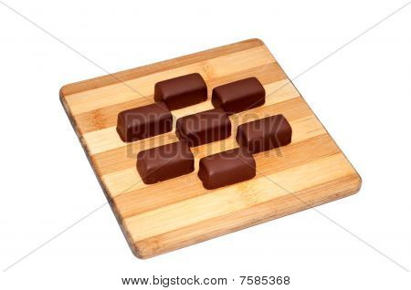 Brown chocolate candies isolated on white