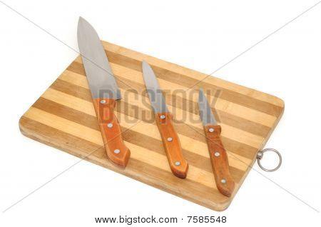 Kitchen knifes on wooden board