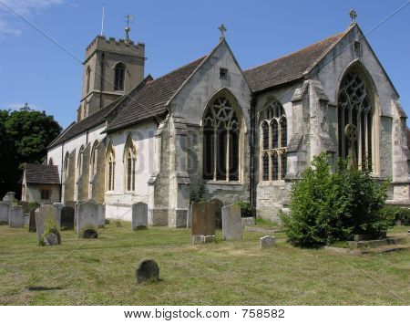 English Gothic stone church and churchyard