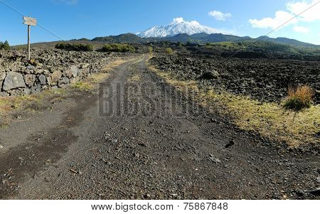 dirt road to the volcano Etna snow covered, Sicily