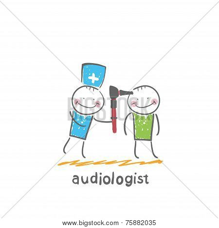 otolaryngologist examines the ear of the patient