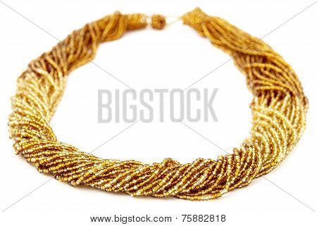 Gold Colored Multistrand Twisted Beaded Neckwear, Traditionally African, Isolated on White Backgroun